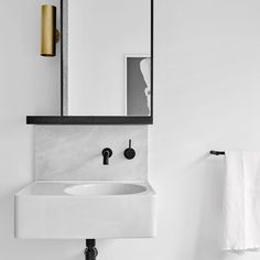 One of the Guest bathrooms at Bendigo Residence with a favourite wall light of mine by @annacharlesworthmetal @brookeholm Art Direction: @marshagolemac #flackstudio #BendigoResidencebyFlackStudio Artwork in the reflection is by @zoecroggon represented by @dainesinger Gallery by flackstudio