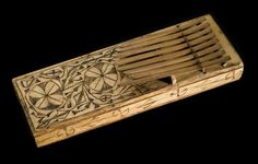 Sansa or thumb piano consisting of a flat rectangular box of pale wood ornamented with pyro-engraved patterns, on top of which are mounted eight cane strip keys: Africa, West Africa, Nigeria, Southeastern State, Calabar, Efik people