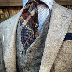 Men's #Fashion: Great winter look... Nice grey tweed suit, white striped shirt and awesome plaid tweed tie