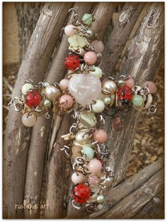 Use brighter beads with only small amount of red and have a larger  center red bead. Also consider wire wrapping.