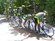 Photograph by Team Rwanda Cycling, 2007:   During a race in Moab, Utah, members of Team Rwanda Cycling stop to touch some snow as it was the team's first time ever seeing it!