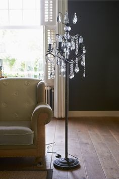 Rivièra Maison Chaumont Chandelier. I'm fond of the black wall and the shutters.