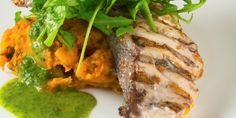 Grilled fish steaks with pumpkin mash and spinach salad