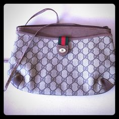 Gucci. Rare and authentic handbag/clutch. Gucci. Rare and authentic handbag/clutch. Can be used as a clutch or with detachable strap. Handbag is in good condition, no peeling inside of bag, serial numbers shown, handbag has much more use. Size 8 inches long, 6 inches in height, 1 inch in width. Gucci Bags Clutches & Wristlets