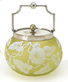 An English silver-plate-mounted cameo glass biscuit barrel, early 20th century. Lime green glass overlaid in white & cut with flowering ivy.