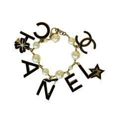 1stdibs - Chanel Pearl and Logo Charm Bracelet explore items from 1,700  global dealers at 1stdibs.com