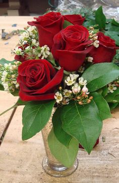 This is an arrangement of red roses.  See our entire selection at www.starflor.com.  To purchase any of our floral selections, as gifts or décor, please call us at 800.520.8999 or visit our e-commerce portal at www.Starbrightnyc.com. This composition of flowers is generally available for same day delivery in New York City (NYC). RO082