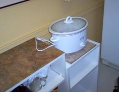 Shorter counter (table or small bookcase?) to make Crockpot more reachable