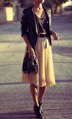 Style tip: tuck in a beautiful blouse into a pleated skirt and cinch waist with a stylish belt!