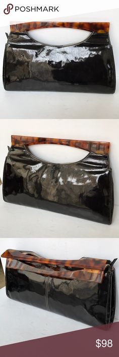 Tommy Hilfiger black patent clutch tortoise shell! Gorgeous Tommy Hilfiger runway boutique collection  Black patent leather clutch  Beautiful Tortoise shell handles Oversized Clean inside Smoke and pet free home Please see my other designer items! Tommy Hilfiger Bags Clutches & Wristlets