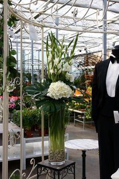 Curvy black glass vases showcase a burst of all white gladiolus