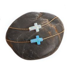 Beautiful, iridescent Fire Opal Crosses by MyLittleLuxuryShop on Etsy, $25.00 (available in sideways or straight up and down and colors are baby blue and white) www.LittleLuxuryShop.com