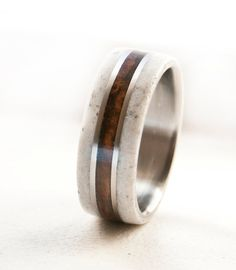 Side shot - Handmade wedding ring - Elk antler on either side of wood divided by titanium.