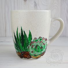 http://sosuperawesome.com/post/169012664809/hand-painted-mugs-by-natalia-savelieva-on-etsy