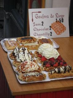 Gaufres. Belgian waffles from a street vendor in Brussels...the best thing I have ever eaten. Really. You don't even need all that business on top.