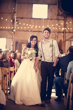 the groom's outfit is simply genius. her dress is also cute. I love the lighting in the background