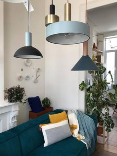 Lighting from Ferm Living and sofa from Fest Amsterdam in Huiszwaluw Home.