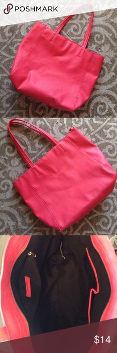 """F21 Hot Pink Bag Beautiful hot pink large bag. Textured faux leather with black fabric inside. Bag used a few times and has VERY faint markings that you'd have to look for to find-see pics. Bag is approximately 13"""" H x 17"""" L x 5.5"""" W Forever 21 Bags"""