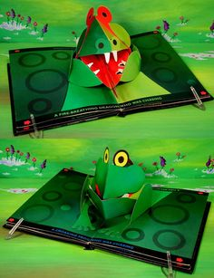 A Forward-and-Backward Pop-Up Book Hot Pursuit, vintage children's pop-up book, 1987 by Kees Moerbeek and Carla Dijs. Page 2. The Fire-Breathing Dragon chases the Croaking Frog, and the Croaking Frog chases the Fire-Breathing Dragon. (sorry, the angle you can't see the flame in his mouth).