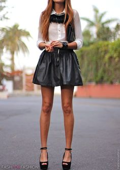 babe in a leather skirt and killer necklace