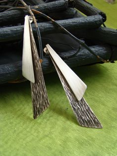 silver earrings carved with patina