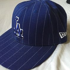 Vintage LA Dodgers snapback Blue and white pin strip. Clean. No stains. No tears. Smoke free home. In great condition. Retails for $31.99 + tax Accessories Hats