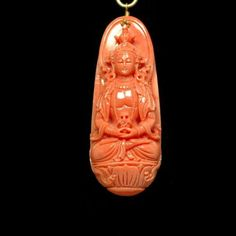 This beautiful pendant is hand carved out of China Seas red coral depicting celestial Amitabha Buddha.