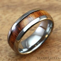 http://www.happylaulea.com/tungsten-rings/tungsten-carbide-ring-with-koa-wood-inlay-8mm-width-barrel-style
