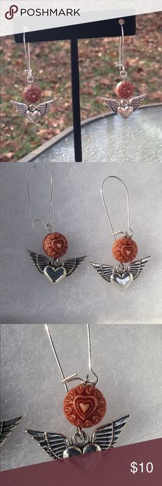 Hearts and Angel Wings Wood Silver Earrings Pictured: Wood hearts and silver angel wings earrings.   These unique earrings feature wooden beads and silver tone charms. The hooks are silver tone and are hypoallergenic.   All PeaceFrog jewelry items are handmade by me! Take a look through my boutique for more unique creations. PeaceFrog Jewelry Earrings