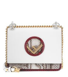 Fendi - Kan I F Small leather shoulder bag - Fendi's Kan I F Small shoulder bag has been crafted in Italy from smooth white leather and comes with a glossy gold-tone F detail for recognition. Exotic python leather lends textural intrigue to the new-season style, while the golden chainlink strap makes a glossy statement. seen @ www.mytheresa.com