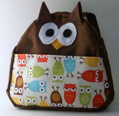 Owl backpack - no pattern, but it should be easy enough to modify a bakpack pattern to owl-ize it :D