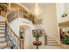 Grand foyer with double stair case | Lincoln, RI