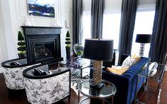 Living room - navy velvet sofa, black and white room