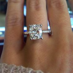 Cushion Cut solitaire engagement ring on a thin diamond band #IndyFacets #cushioncut #wedding