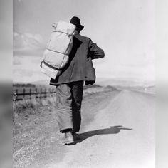1935; Migrant worker on California highway; Dorothea Lange