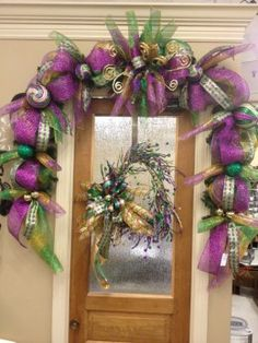 Elaborate swag with wreath on door.