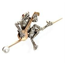 Victorian diamond set frog novelty bar brooch, the old and rose-cut diamond frog seated on a bar terminated in a pearl and playing a golden banjo, the diamonds silver set and mounted on gold, circa 1890