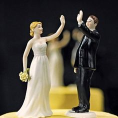 This funny wedding cake topper will show everyone that you're marrying your best friend.  The bride and groom on this cake topper are giving each other a high five that  will add a humorous touch to your wedding cake.