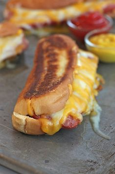 Grilled Cheese Hot Dogs - Slice the hotdogs almost in half, and grill them before making the sandwich.