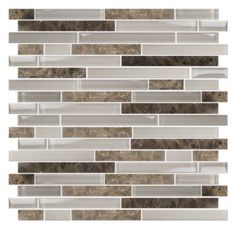This mosaic stria is a blend of frosted and glossy glass in two tones of tan and taupe combined with several shades of Emperador Marble. A charming blend of traditional marble with a modern glass element that is sure to be the star in any space.