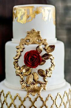 Ornate gold makes this Beauty and the Beast inspired wedding cake one to emulate! #goldweddingcakes #weddingcakedesigns