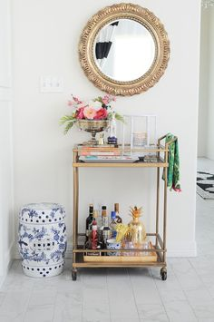 Gold bar cart styling tips and ideas for spring. Love the chinoiserie vibe and bright florals. Bar Cart ideas for home, office, or workplace. Diy Bar Cart, Gold Bar Cart, Bar Cart Decor, Bar Cart Styling, Bar Chairs, Bar Stools, Desk Chairs, Decorating Blogs, Interior Decorating
