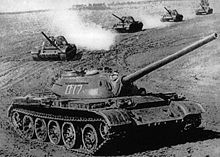 "T-54/55. The successor to the T-34, the T-55 was the primary Soviet tank of the Cold War era. Classified as a ""medium tank,"" it is the most produced tank in the World. It saw service in many conflicts, including Vietnam, the Indo -Pakistani wars, the Arab - Israeli wars, the Iran- Iraq war and several conflicts in Africa. It is still in service with armies throughout the world. Known for being rugged and easy to operate, it's primary drawback is a lack of space for the crew."
