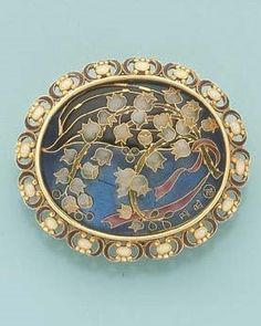 AN ART NOUVEAU ENAMEL BROOCH BY ANDRE AUCOC. Composed of gold and plique-à-jour enamel, circa 1900