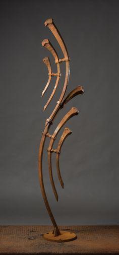Dane Stevens Artist Blacksmith, degree piece 7ft tall