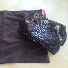 """Kate Spade Printed Handbag Beautiful, fabric and black patent leather handbag. Gold plated hardware. Small middle zipped compartment, 2 side compartments. Approx. 12"""" long x 8"""" deep (soft bag, form shifts). Perfect, like-new condition with original dustbag. kate spade Bags"""