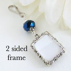 2 sided Wedding bouquet photo charm. Double sided - DIY or I do photos. Metallic blue. Bridal shower gift. Sister gift.  A Wedding bouquet photo charm in antique silver tones, featuring a small 2 sided picture frame and metallic blue crystal.  This beautiful little memorial photo charm can clip onto a brides bouquet, ribbon, or anywhere. Just add your pictures of a loved one, to be part of your special day. The small picture frames have a slot in each corner, to hold your photos in place…