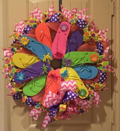 Flip Flop Wreath with 12 flip flops, chevron ribbon, polka dot ribbon, rhinestones with flowers, curly bows and more. Measures about 30 inches wide. At this time we do not ship this size wreath. If yo