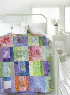 Use batiks in a quick-to-sew bed-size quilt! Delicious sherbet-tones provide the foundation while pretty coordinating prints add a softer touch..