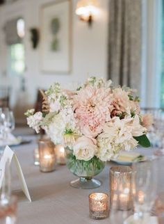 Nice combo of flowers, do not like the vase: low and lush, roses, dahlias, astilbe, white, mercury glass, romantic